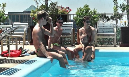 WeHo boys partying at a gay pool party in Los Angeles.
