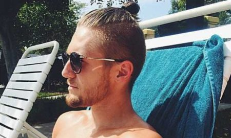A photo of a sexy guy with a topknot.