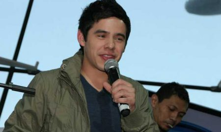 A photo of David Archuleta singing.