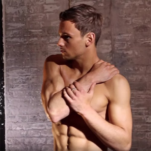 Tom Daley with hand on shoulder