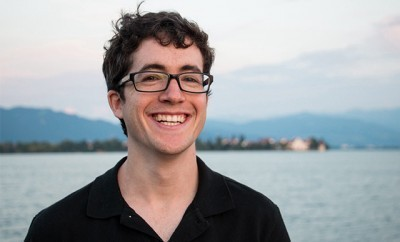 This is a photo of a cute young man wearing glasses.