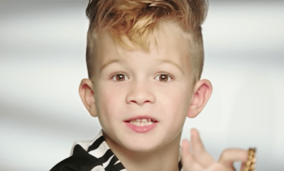 A little boy stars in a Barbie commercial.