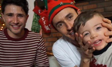 This is a photo of Matt Dallas , his husband Blue Hamilton and their new son.