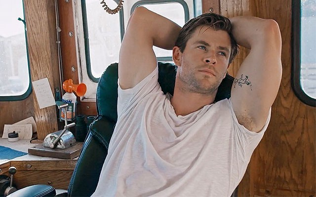 This is a photo of Chris Hemsworth from the short film 'The Man Who Dreams Only of Surfing.'