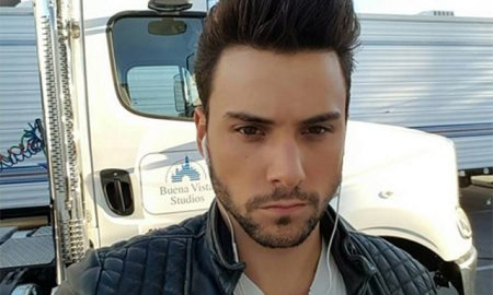 This is a photo of Jack Falahee staring at his co-star's Johnson in the men's room.