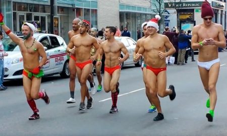 This is a photo of runners participating in the Santa Speedo Run.
