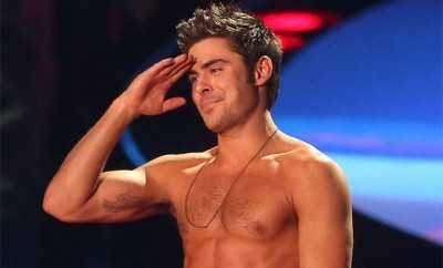 This is a photo of Zac Efron shirtless.