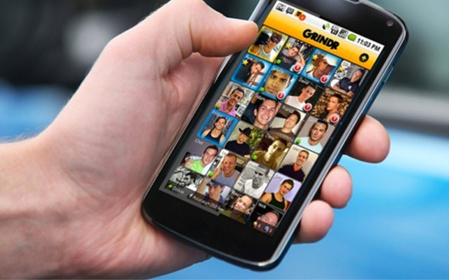 This is a photo of Grindr open on an iPhone.