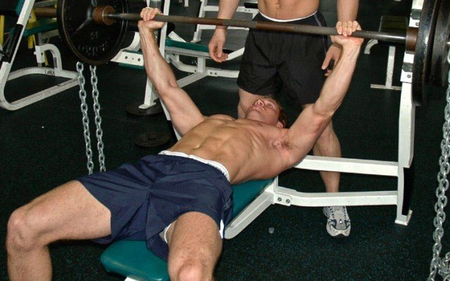 This is a photo of two guys at the gym.