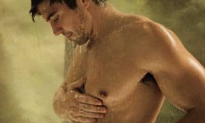 """Steve Grand hits the shower to promote the new """"Steve Grand Pride Edition Tee"""" from Bassackwards Tees."""