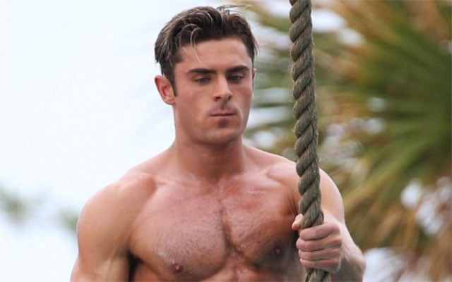 This is a photo of Zac Efron in a Speedo.