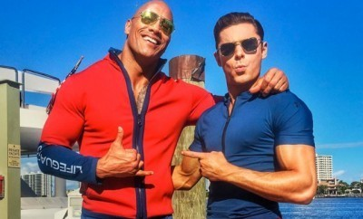 This is a photo of Zac Efron and The Rock.