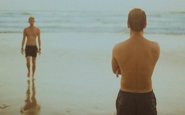 This is a photo of a young couple on the beach.
