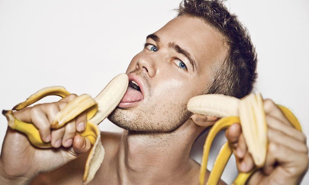 Man holding two bananas