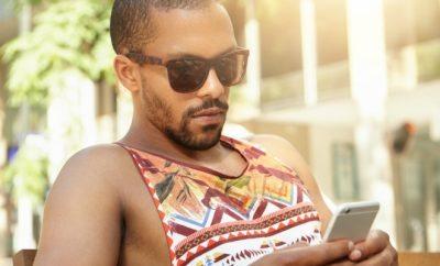 Good looking black guy on his phone