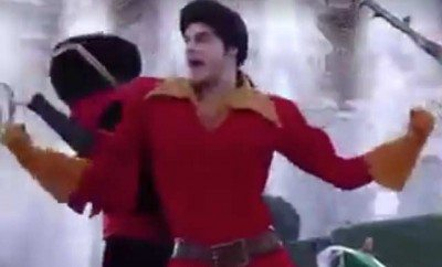 This is a photo of Gaston dancing in a Disney theme park.