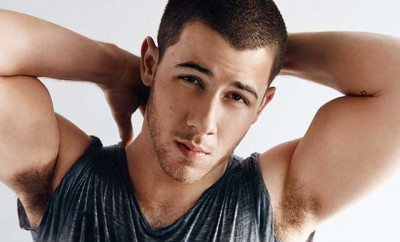 This is a photo of Nick Jonas from 'OUT Magazine'.