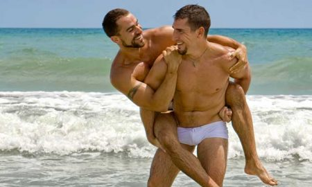 Gay couple on the beach in California.