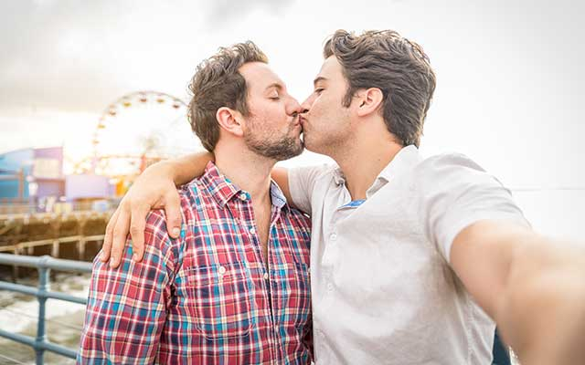 Adorable gay couple kissing.