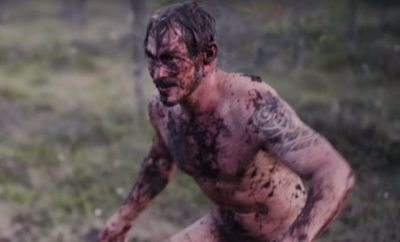 Finnish Men Mud Wrestle in Swamp