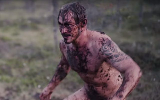 Finnish Men Mud Wrestle in Swamp