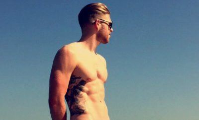 Adam Clayton on the beach.