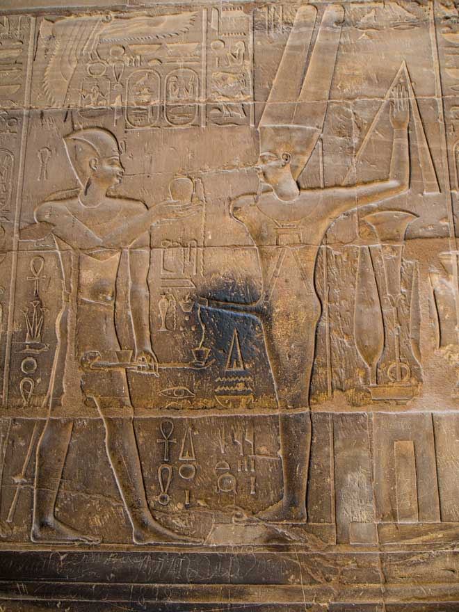 Relief of the God Min, carved upon the walls of Luxor temple, Egypt