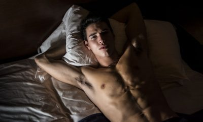 Gay man laying in bed