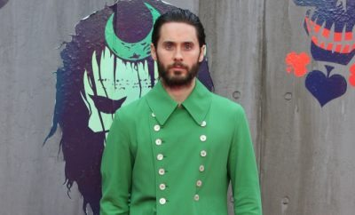 Jared Leto in a green jacket