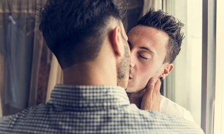 A gay Mormon couple kissing