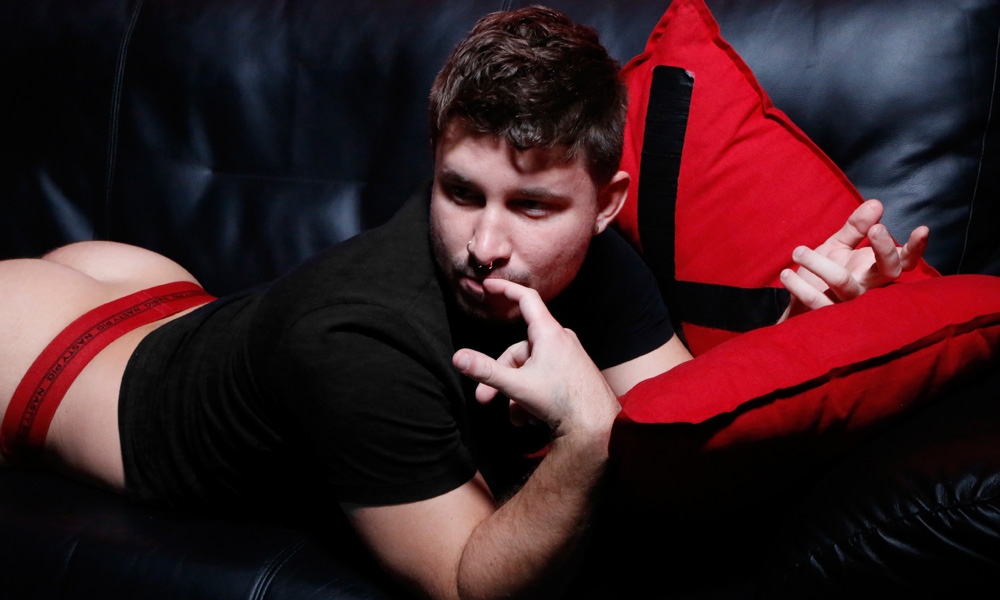 Alex Cheves on a sofa