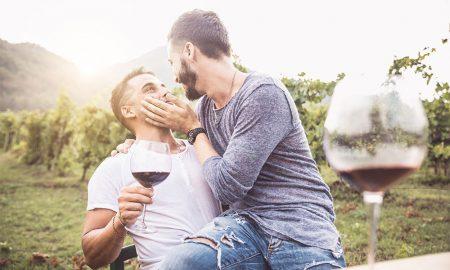 Gay couple drinking wine