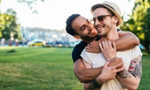 Multi ethnic gay couple hugging