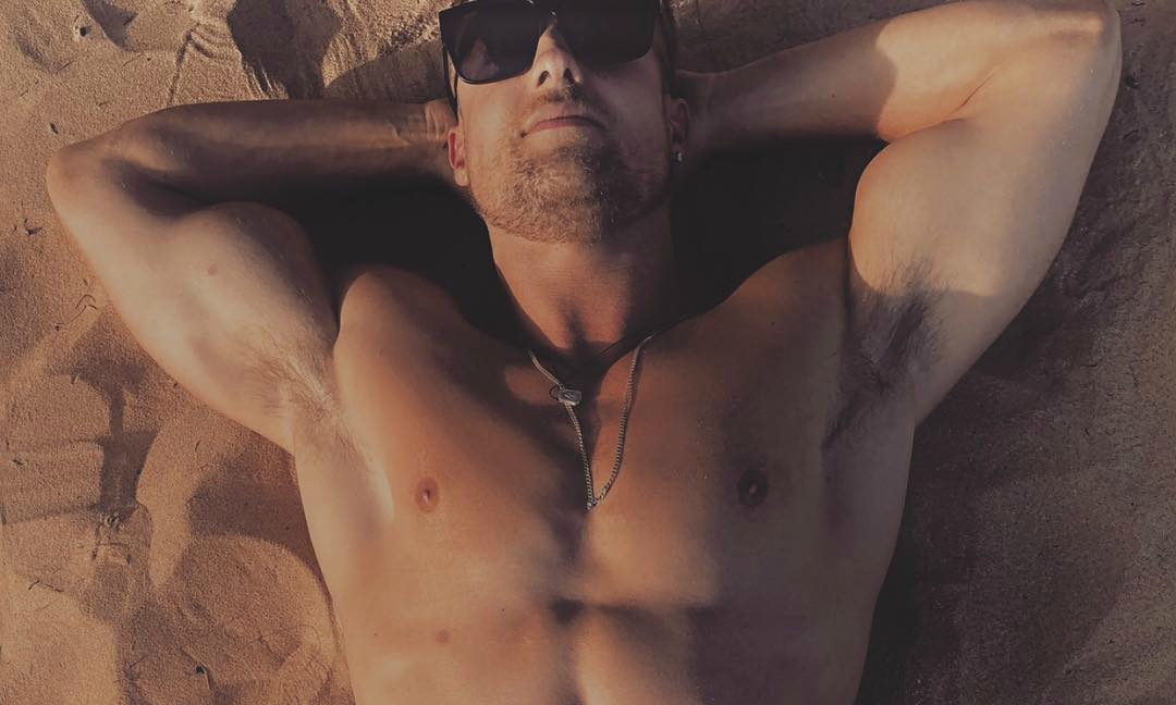 Simon Sherry-Wood Lays out at a Beach