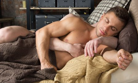 Two gay men in bed sleeping