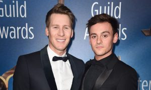 Dustin Lance Black and Tom Daley attends the 2018 Writers Guild Awards