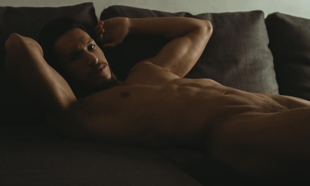 Man lays bare on a sofa