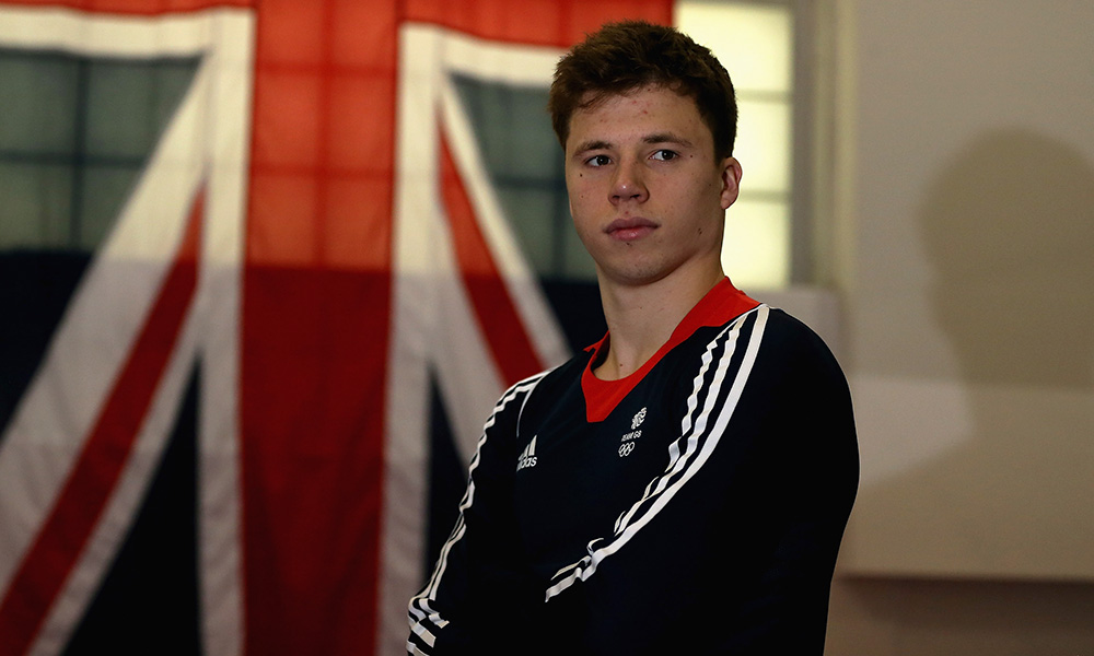 Freddie Woodward of Britain poses for a picture as the Team GB diving team