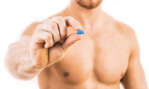 Man holding a PrEP pill