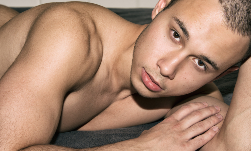 Young man resting on the bed.