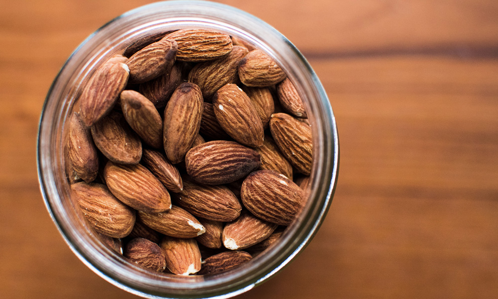 A jar full of almonds.