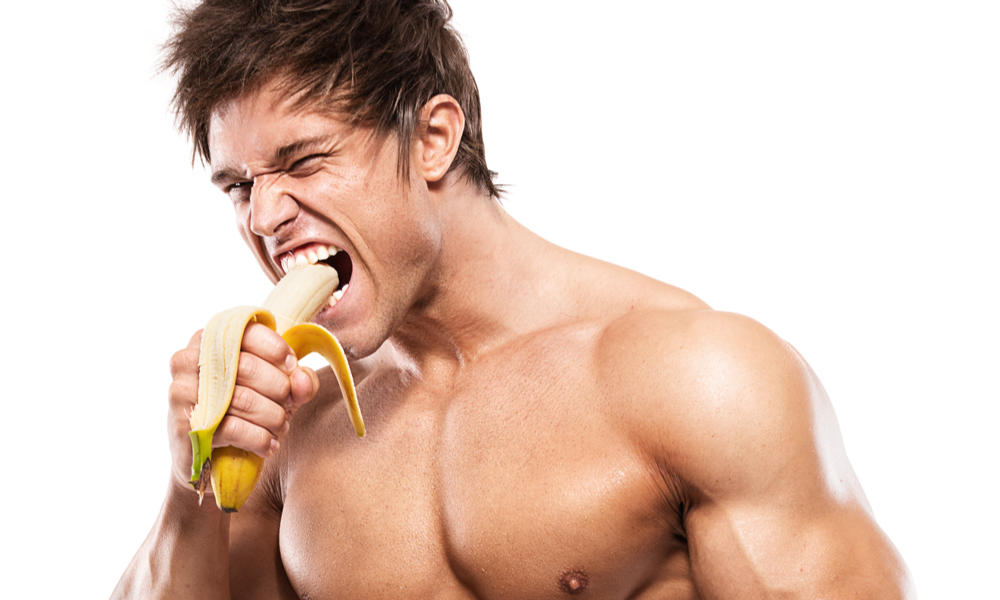 Man eating a banana to boost testosterone