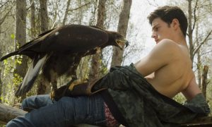 Photo of a model with a golden eagle by Walter Jenkel