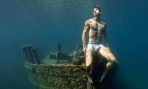 A photo of a male model underwater by Lucas Murnaghan