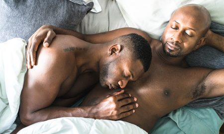 Gay black couple relaxing in bed