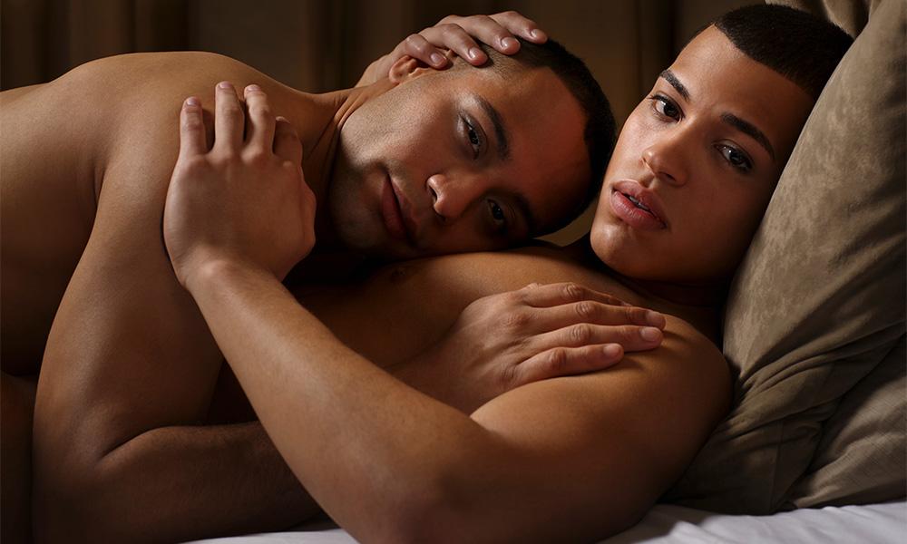 Gay black couple cuddling