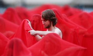 Participants pose as part of Spencer Tunick's nude art installation Return of the Nude