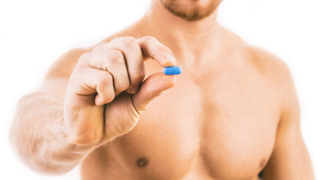 Man holding a HIV prevention pill. PrEP