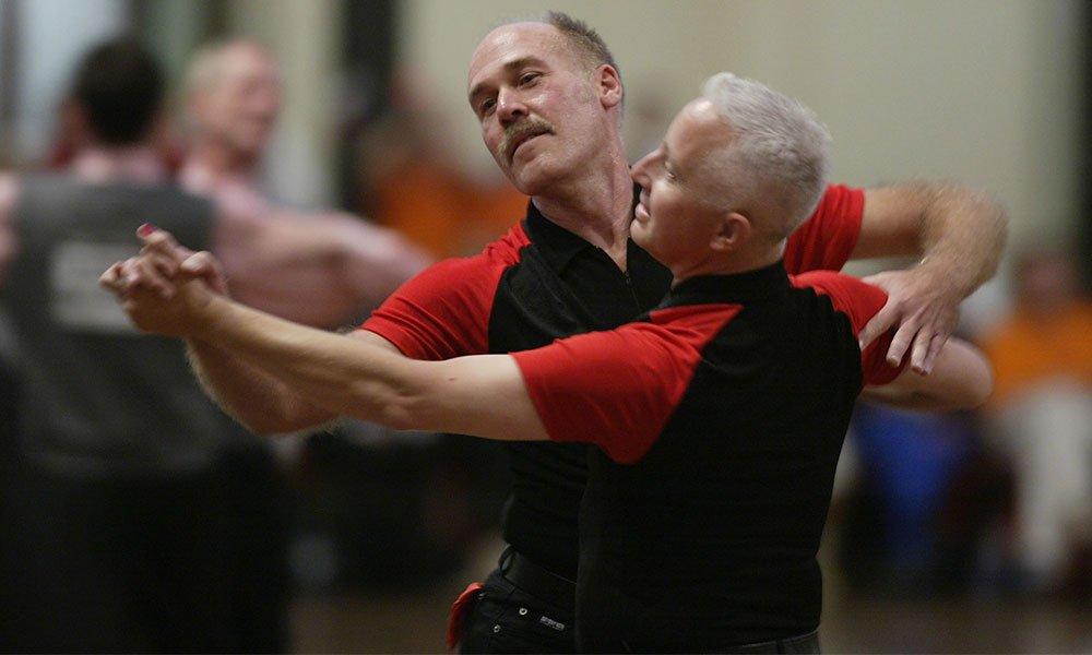 Paul van Houten and partner Gary Dougan in action during the Mens graded Modern Dancing competition