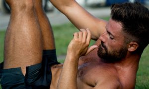 Man stretching on the lawn